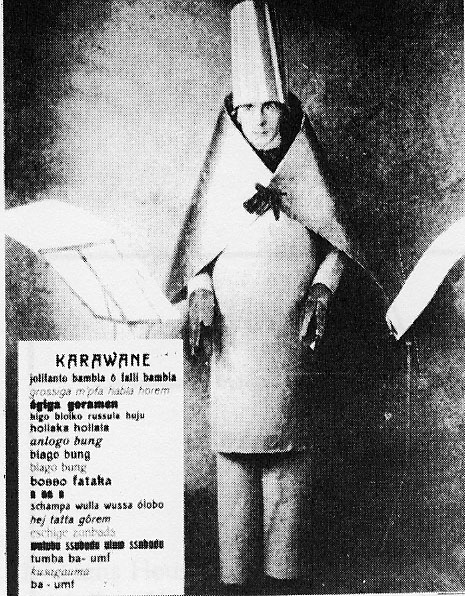 Hugo Ball in cubist costume performing Karawane, 1916