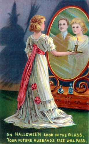 """An early 20th century Halloween post card which says """"On Halloween look in the glass. Your future husband's face will pass."""""""