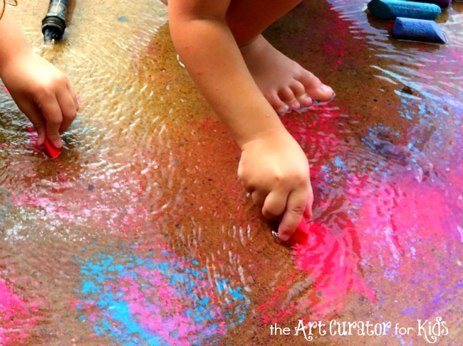 The Art Curator for Kids - Sensory Color-Mixing Art Activity with Chalk and Water - Girls Hands