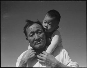 The Art Curator for Kids - Fathers in Art History - Dorothea Lange, Manzanar Relocation Center, Manzanar, California, Grandfather and grandson of Japanese ancestry, 1942
